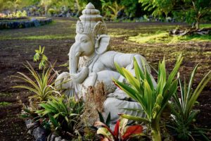 Elephant statue surrounded by garden plants