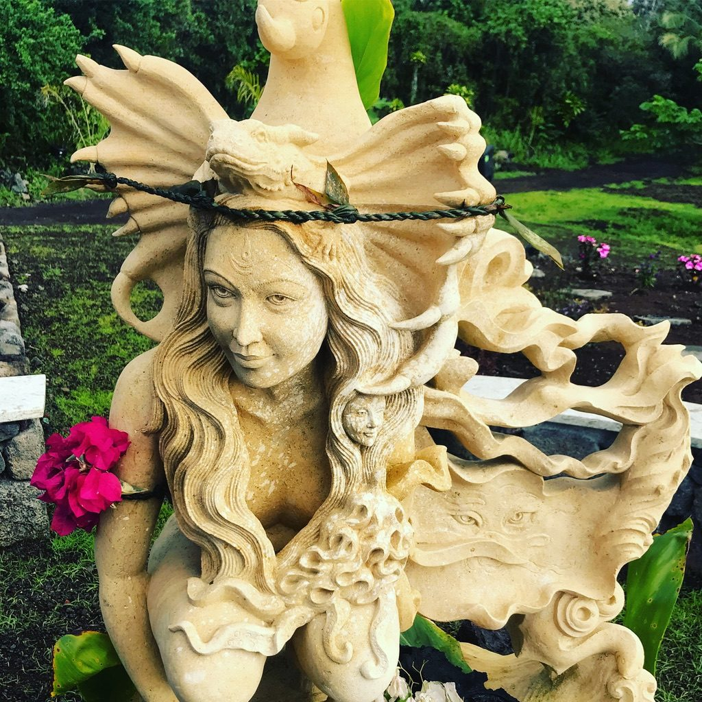 Statue in garden with flowers